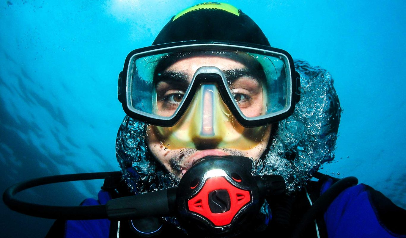 Diver in water with mask